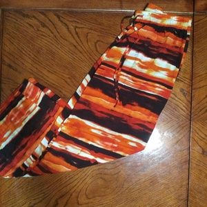 Orange and black abstract wide legged pants